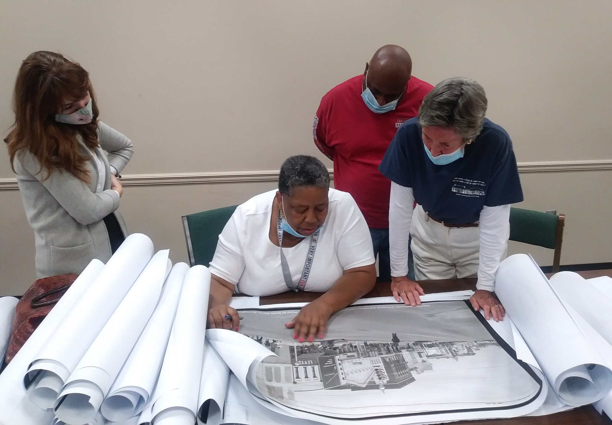 From left to right, Rachel Metcalf from the City of Selma, marcher JoAnn Bland, Selma Times reporter James Jones and Selma Public Library Director Becky Nichols recently met up to look at historic photos. Bland identified herself in one of the photos for the first time thanks to the project.