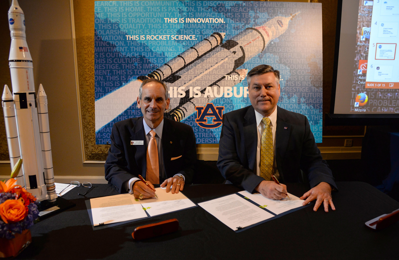 John Mason signing NASA agreement