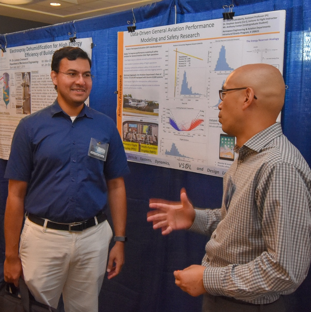 presenter at 2019 faculty symposium discusses research poster