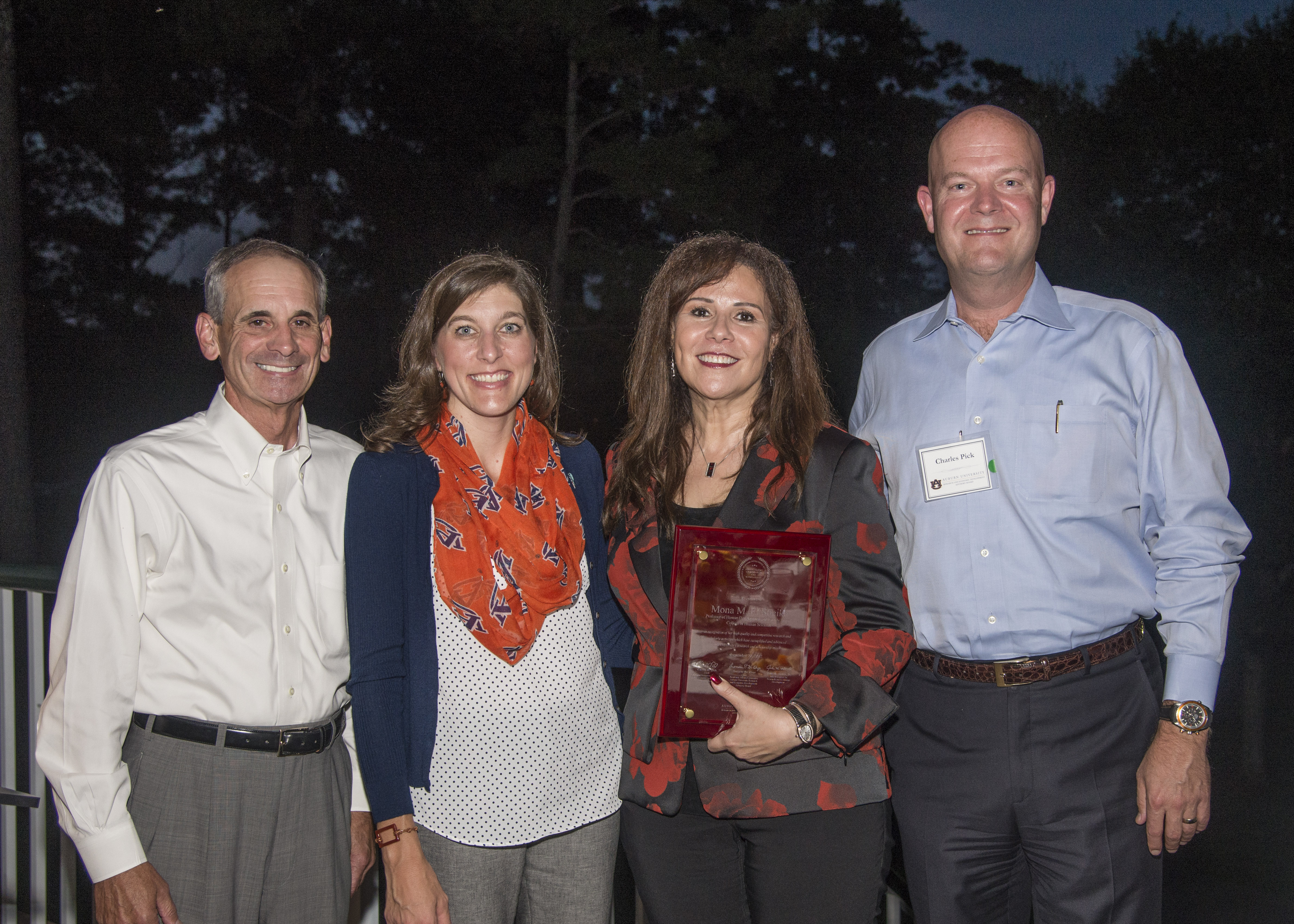 Dr. Mona El-Sheikh holds a plaque recognizing her as recipient of Auburn University's 2017 Research and Economic Development Advisory Board Advancement of Research and Scholarship Achievement Award. Also pictured: Dr. John Mason, vice president for research and economic development; Dr. Lori St. Onge, board member; and Charles Pick, board member.