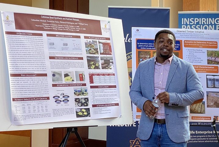 Johnathan Mitchell, Tuskegee University graduate student, presents research poster