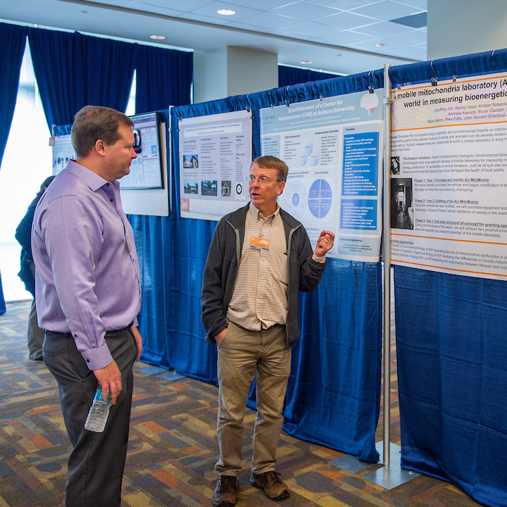 Mark Liles listens to Geoff Hill at the 2018 Auburn Research Faculty Symposium