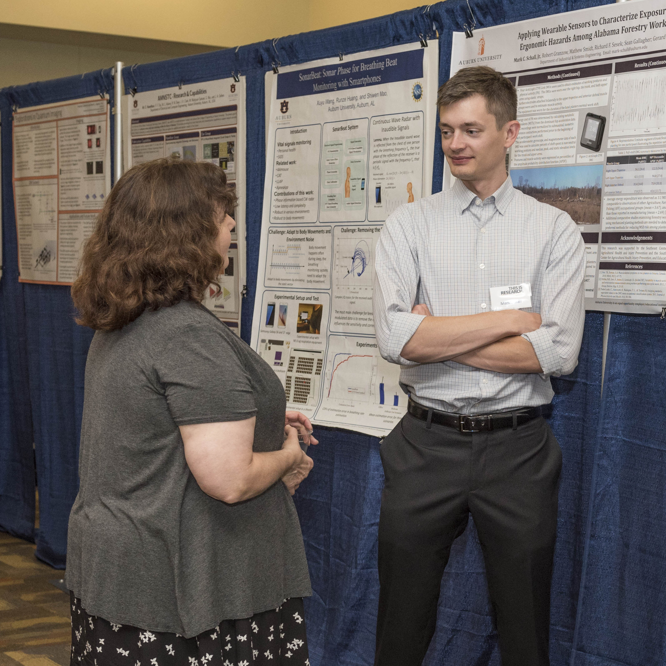 Auburn Research Faculty Symposium presenter discussing poster