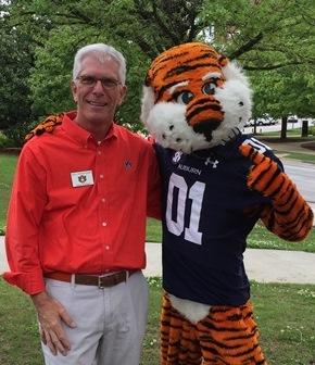 Photo of Dean Gregg Newschwander and Aubie the tiger
