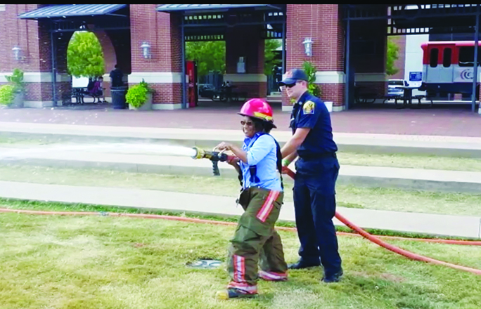 Firefighter teaches proper water hose technique